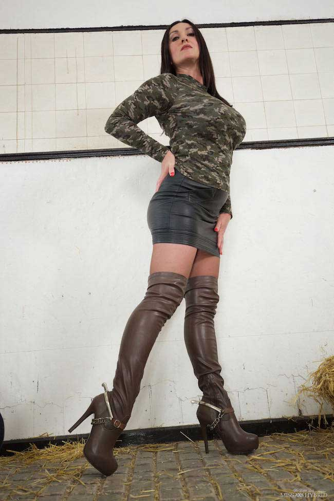 Sexy long leather thigh boots, spurs and figure hugging camo top, Miss Hybrid in the stables.