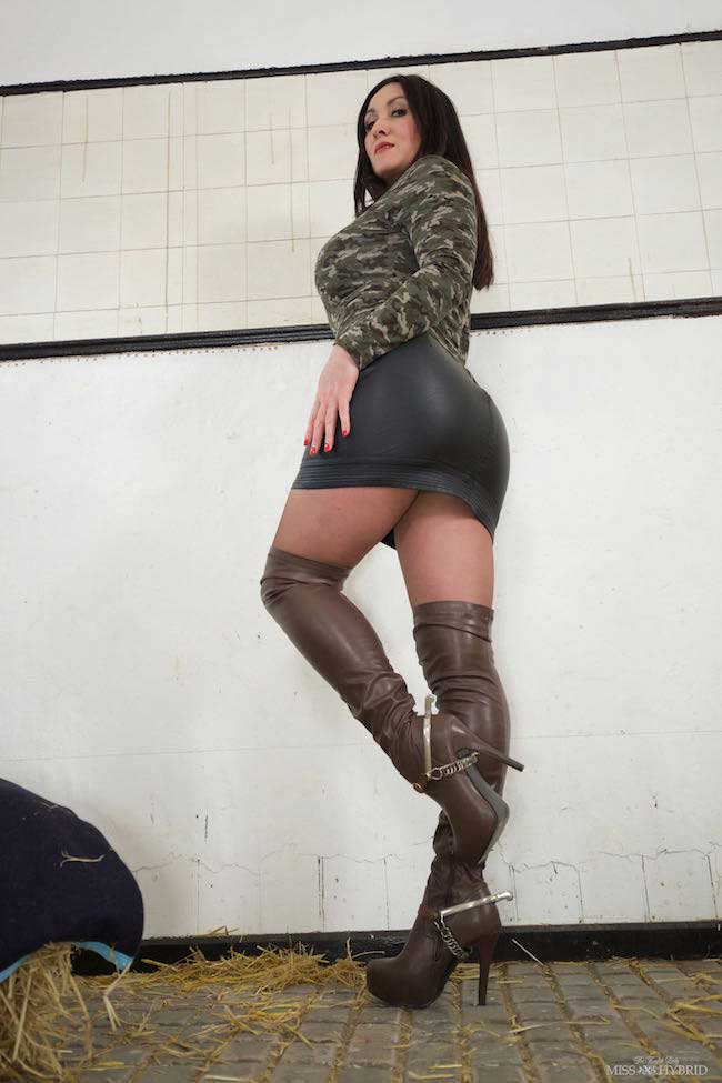 Sexy long leather thigh boots and short leather skirt.