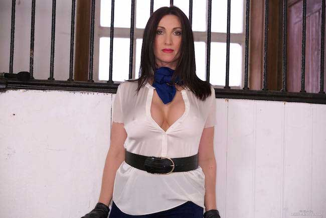 Miss Hybridcleavage revealing blouse, huge tits, jodhpurs, gloves and boots in the stables.